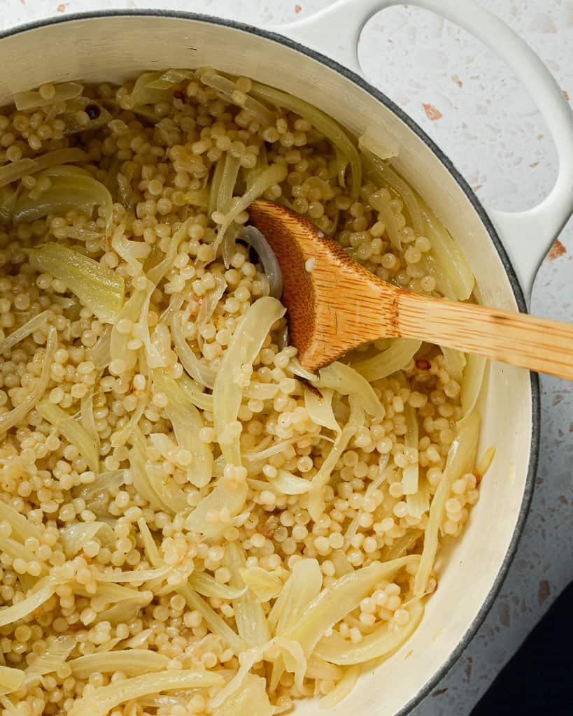cooking couscous in caramelized fennel and onion