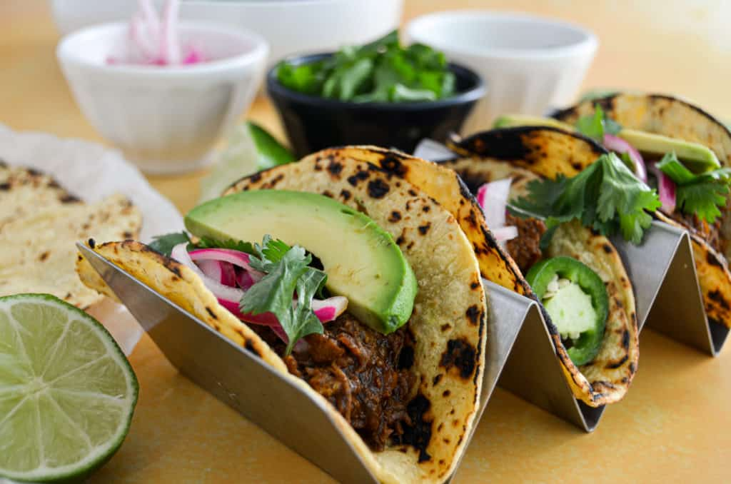 slow-cooked beef barbacoa tacos close-up