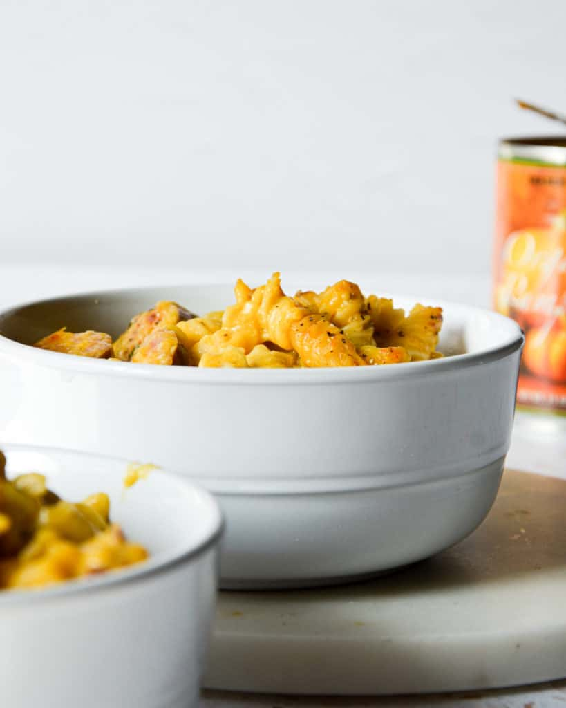 Dairy-Free GLuten-Free pumpkin mac and cheese with kielbasa in bowls.