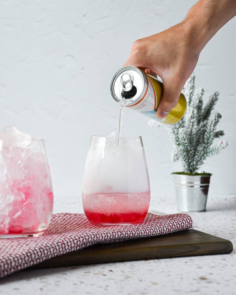 Homemade, All-Natural Cranberry Soda pour