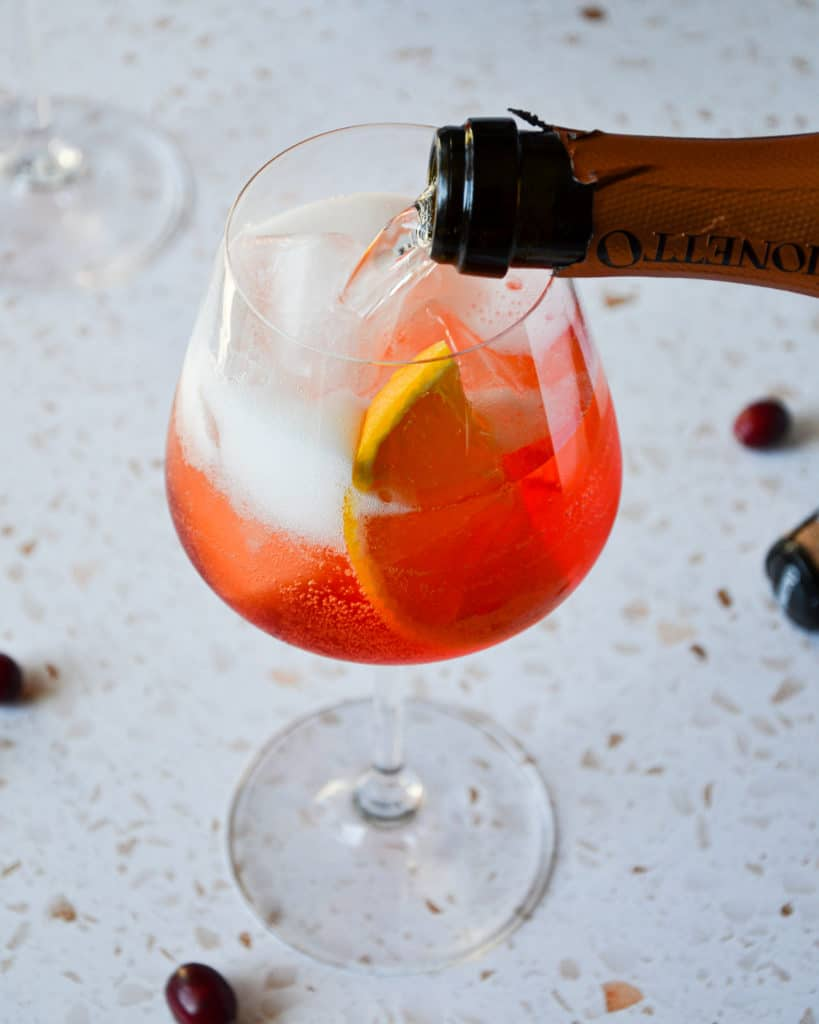 Spiced Orange & Cranberry Winter Aperol Spritz -pour mionetto