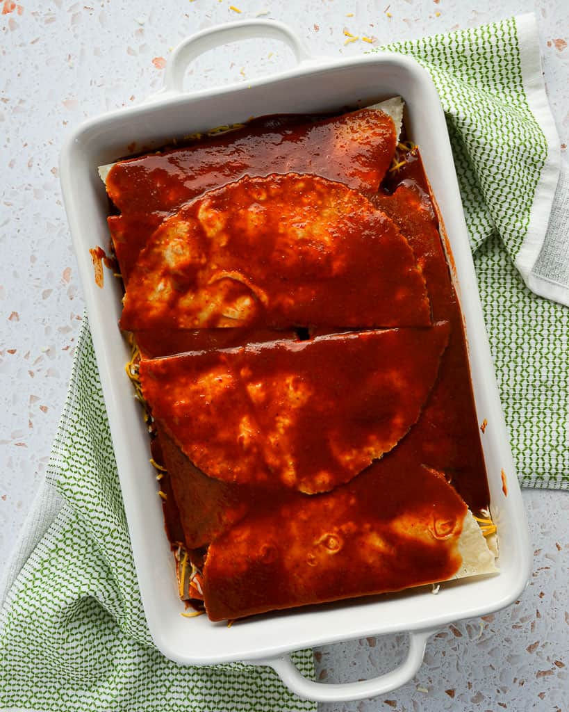 Gluten-Free Beef Chorizo, Kale & Sweet Potato Enchilada Casserole - enchilada sauce layer