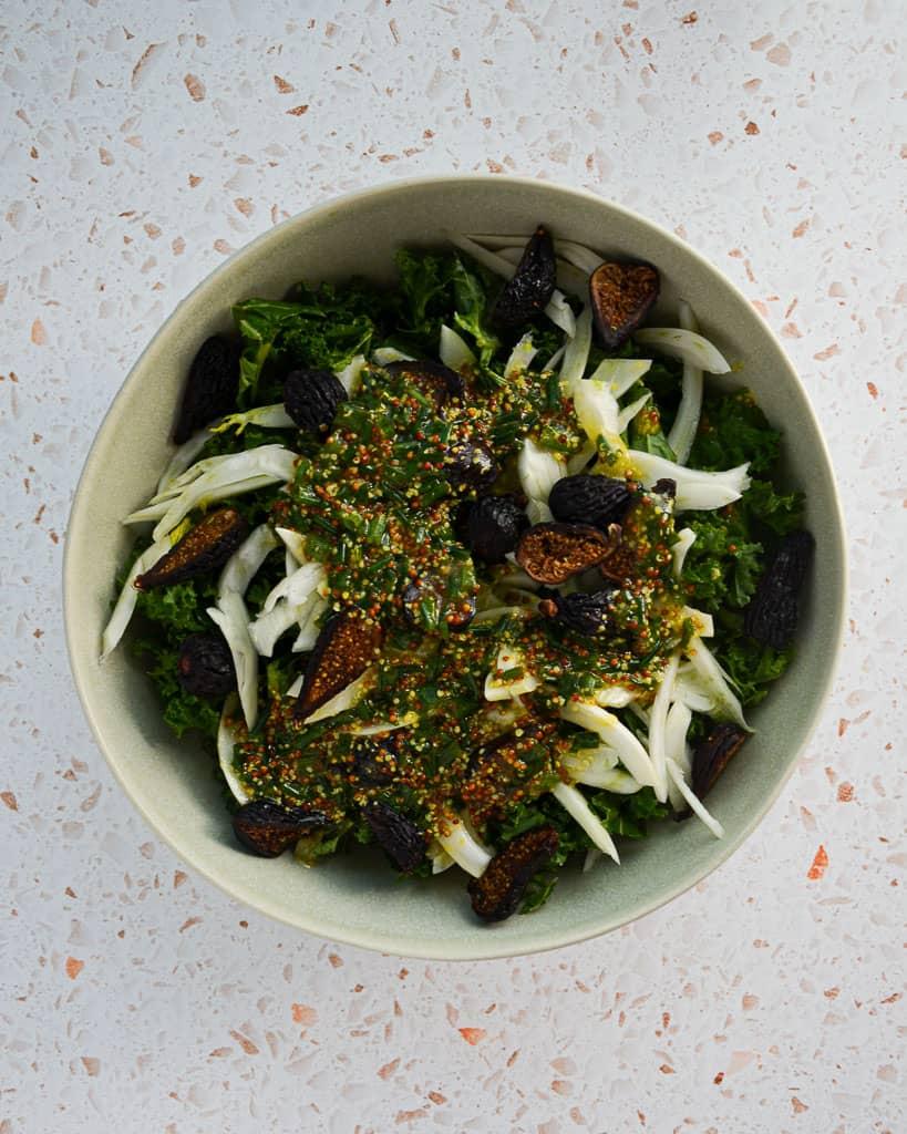 lemon chive dressing on top of kale fennel dried fig salad