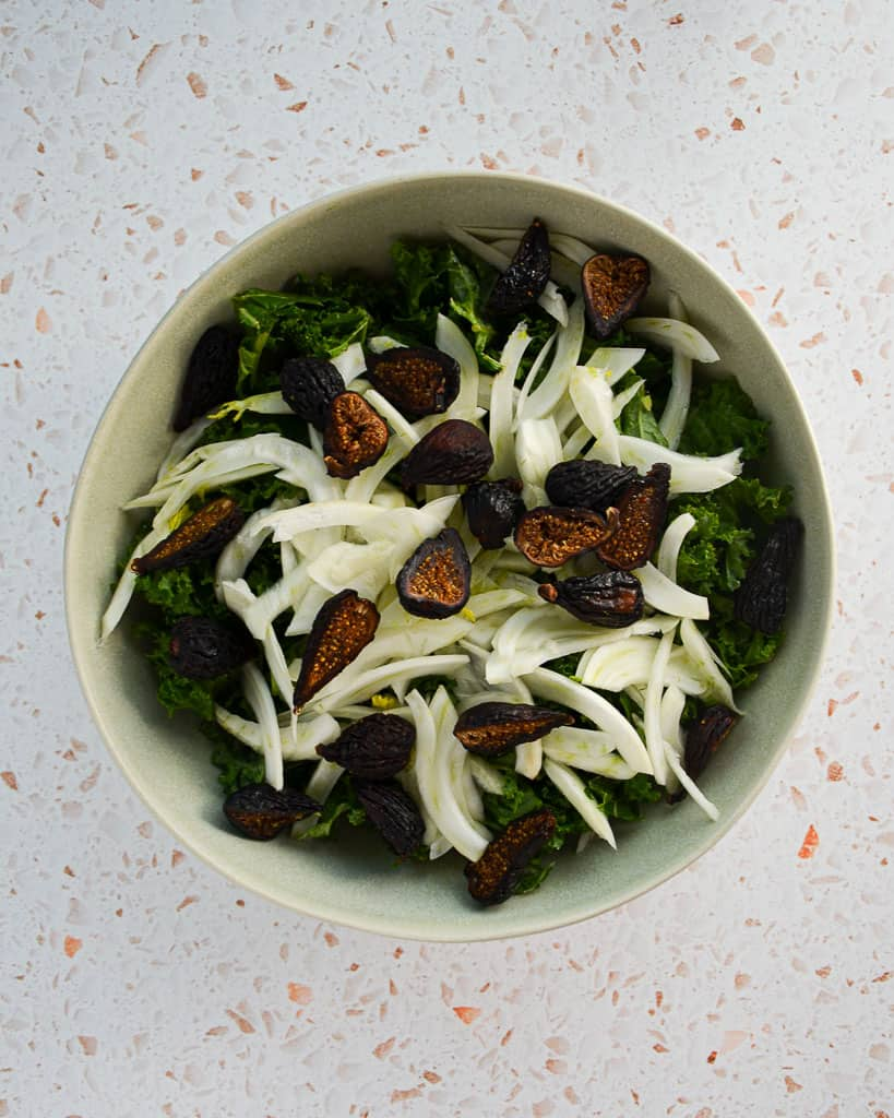 kale fennel dried fig salad,kale fennel salad,kale dried fig salad,how long to massage kale,how to prepare fennel for a kale fennel salad,how do i pick the best fennel,can i eat fennel fronds,what does fennel taste like,how to cut fennel,kale fennel and dried fig salad