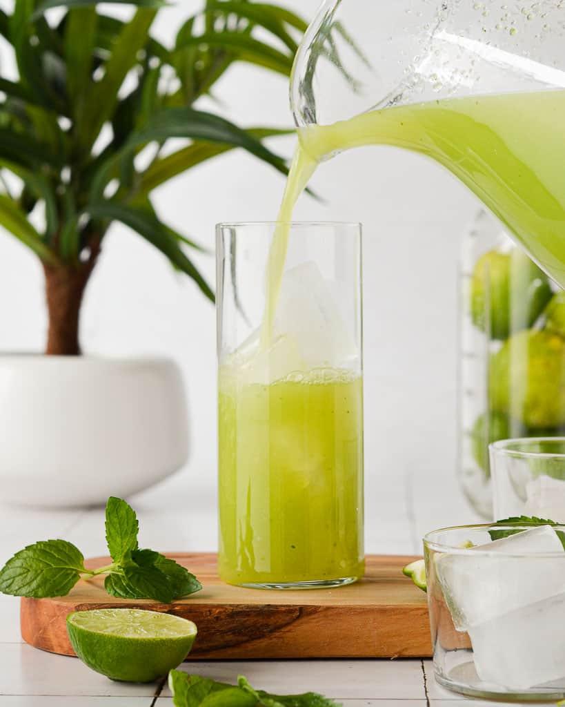 Cucumber Agua Fresca (Agua de Pepino) pouring into a tall glass