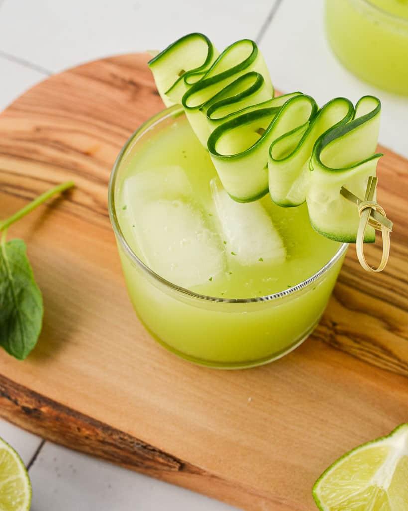 Cucumber Agua Fresca (Agua de Pepino) in a short glass with cucumber garnish