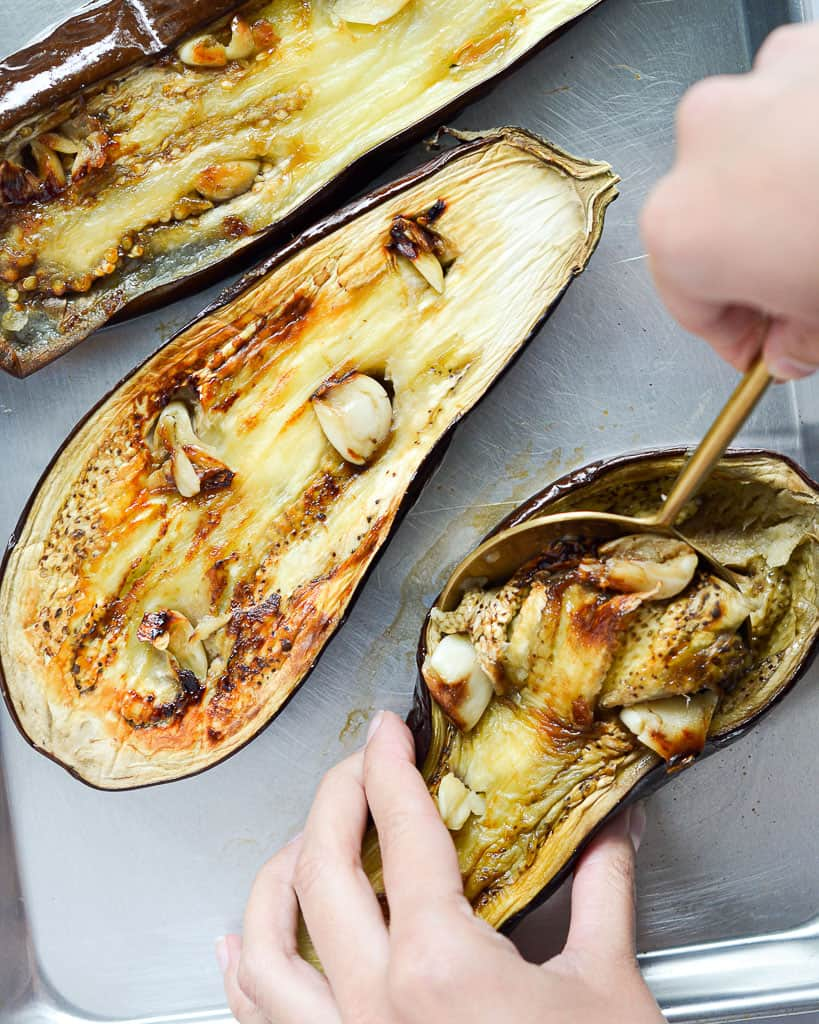 Healthy Greek Roasted Eggplant Dip - scooping eggplant
