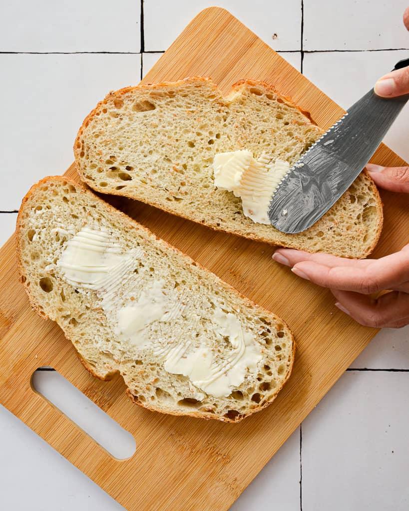Oven Baked Steak and Arugula Sandwich - butter on bread