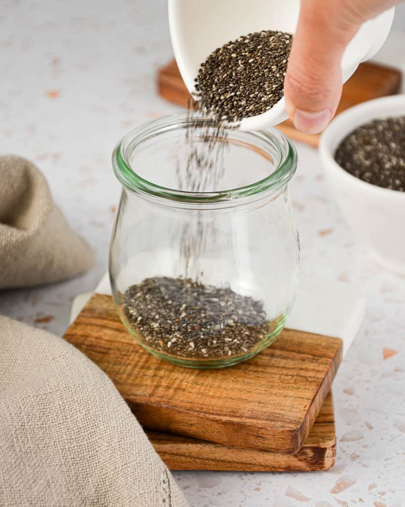 Peanut Butter Chia Pudding - pouring chia seeds