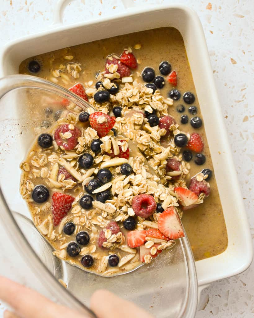 Red White and Blueberry Oatmeal Bake - pouring ingredients into a baking dish