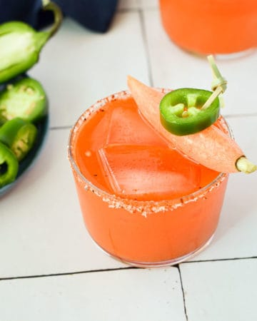 close up of a spicy mezcal margarita with carrot juice