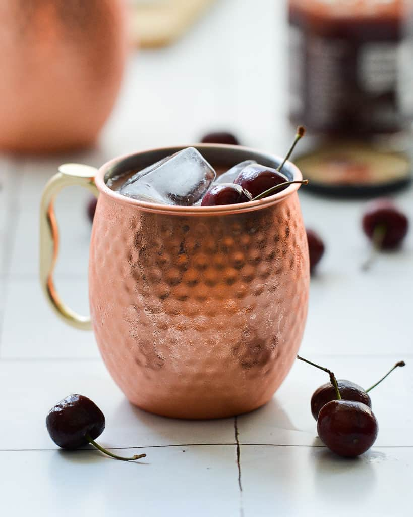 cherry moscow mule with jam in back  - Work With Me