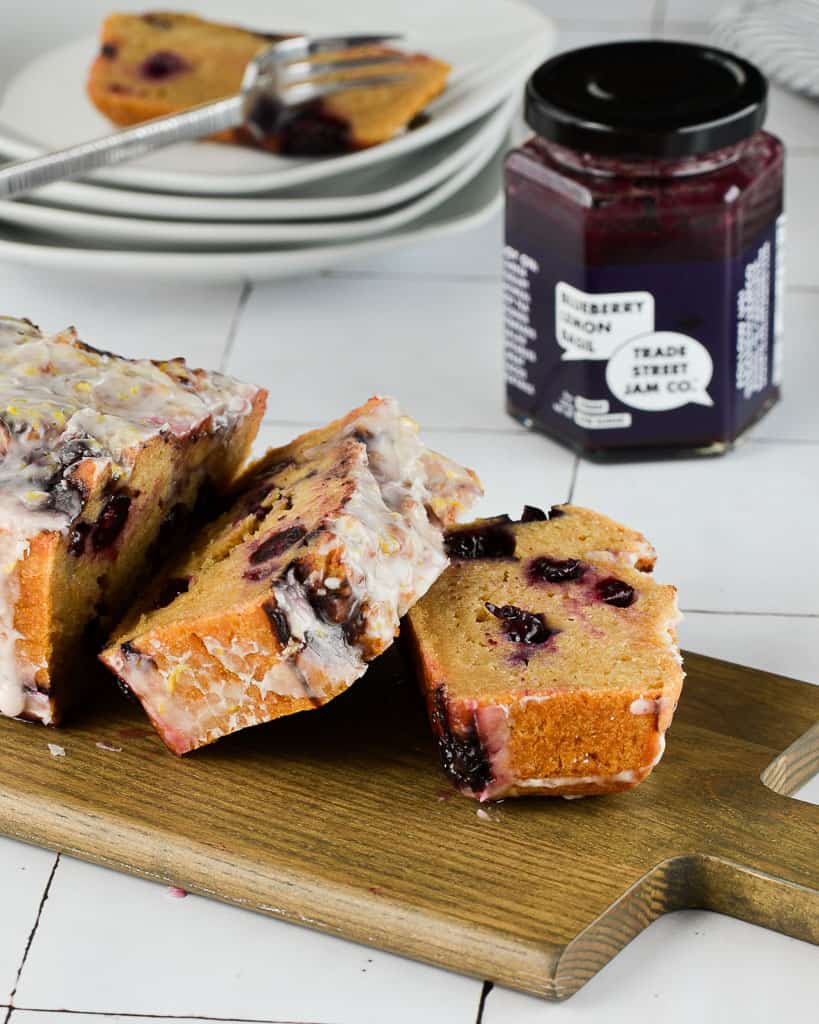 sliced blueberry lemon bread with jam in the back  - Work With Me