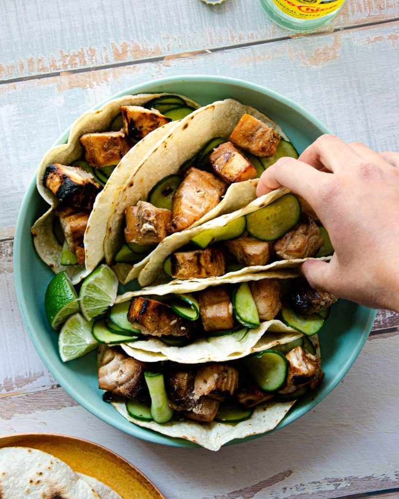 swordfish in tacos paired with cucumber salad