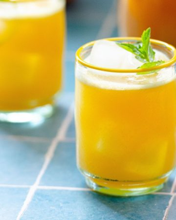 orange agua fresca in a glass / agua de naranja
