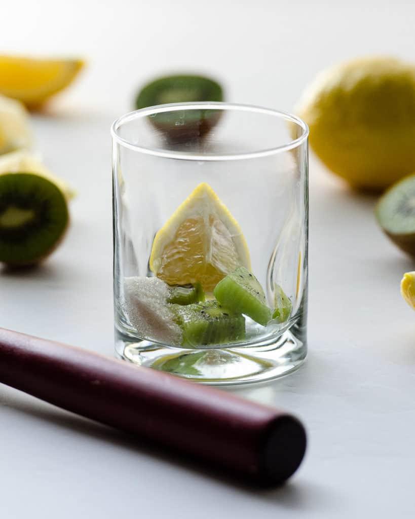 lemon wedges, kiwi, and sugar for a spiked lemonade with kiwi