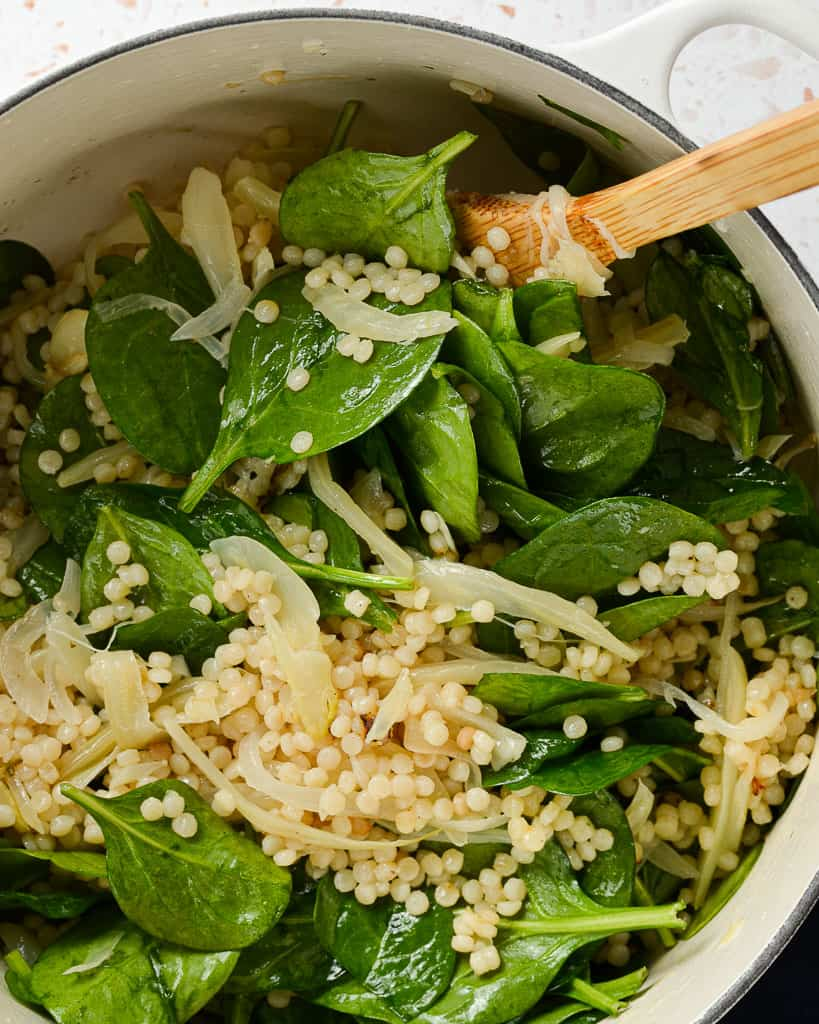 Wilting spinach for a pearled couscous salad