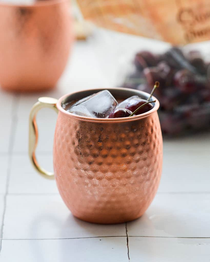 cherries in the back of a moscow mule