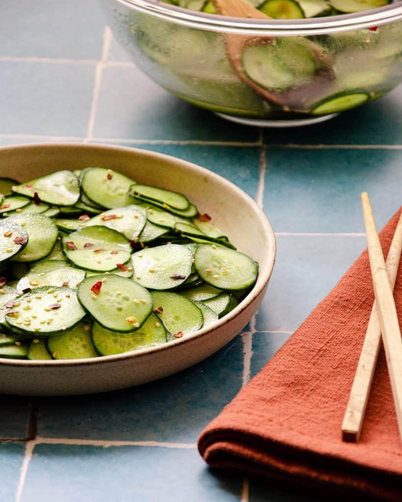 asian cucumber salad up close with chopsticks