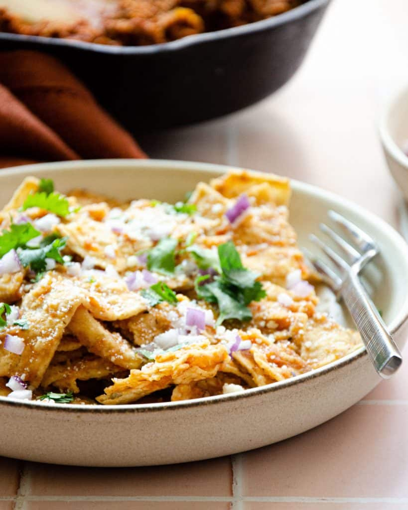 close up of chilaquiles rojos with a fork