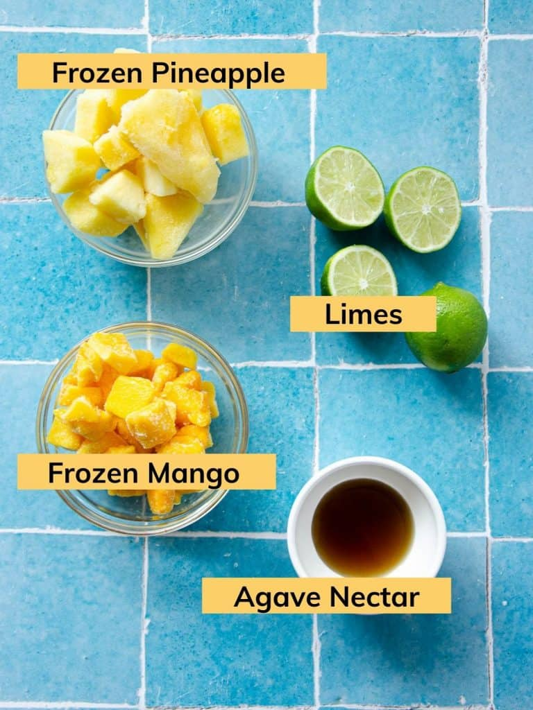 limes, frozen pineapple, frozen mango, and a bowl of agave nectar.