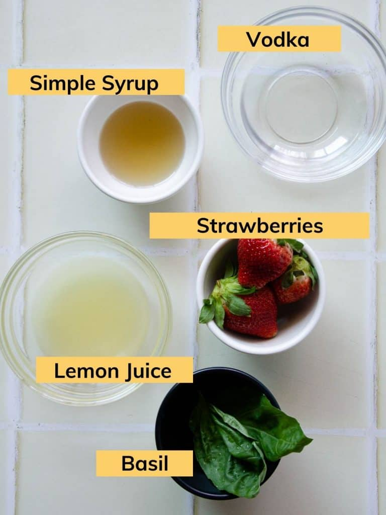 fresh basil leaves, strawberries, lemon juice, simple syrup and vodka all in separate bowls