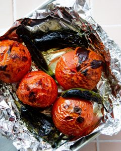 photos of charred tomatoes, serrano peppers and jalapeños