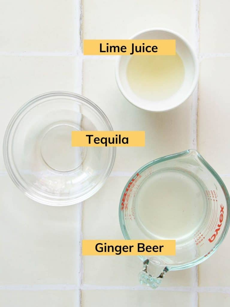 a cup of tequila, a bowl of lime juice and a mug of ginger beer