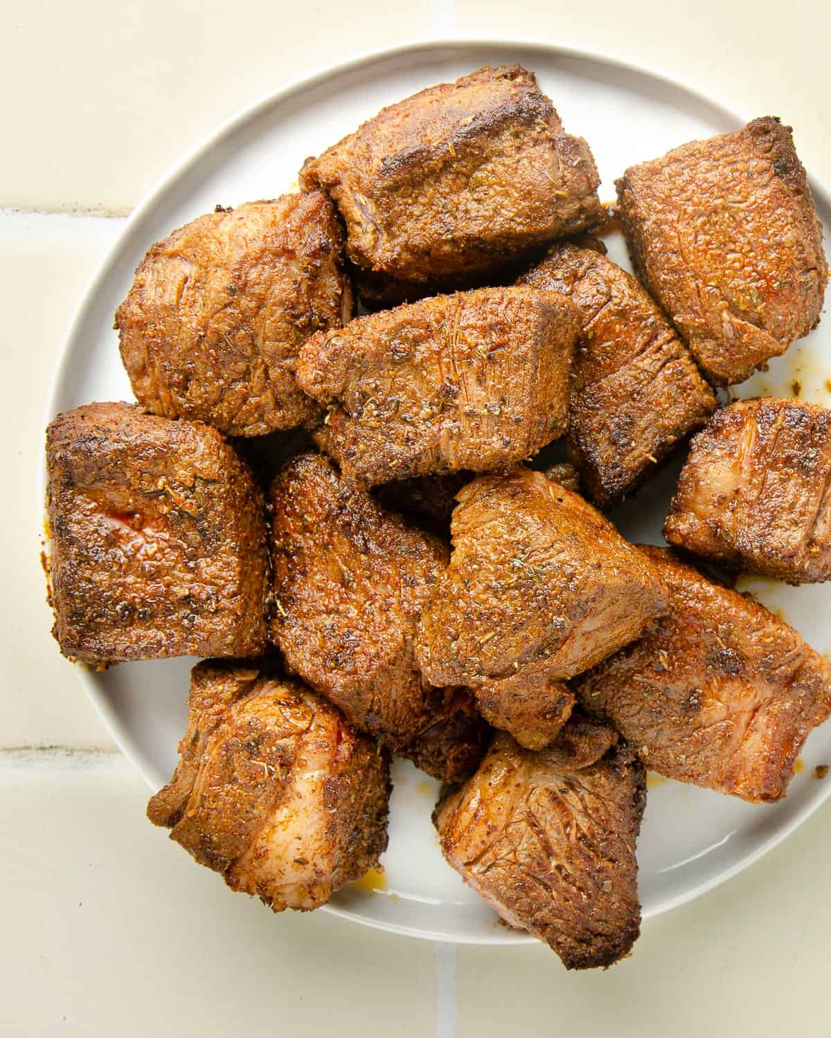 browned cubes of chuck roast in preparation of making the barbacoa beef. Browning is the first step after seasoning the beef cubes.
