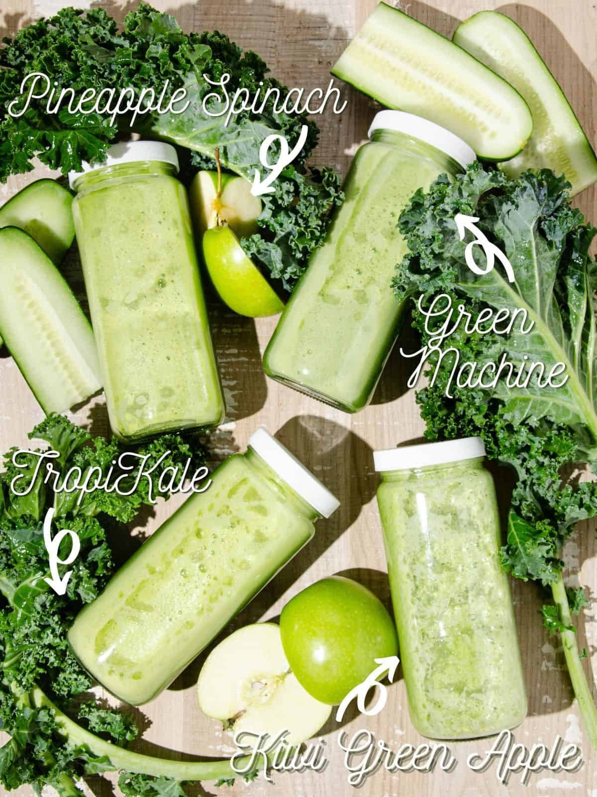 Four Glass bottles of green juice surrounded by chopped kale, green apples and cucumbers. Each bottle is labeled with the corresponding green juice name.
