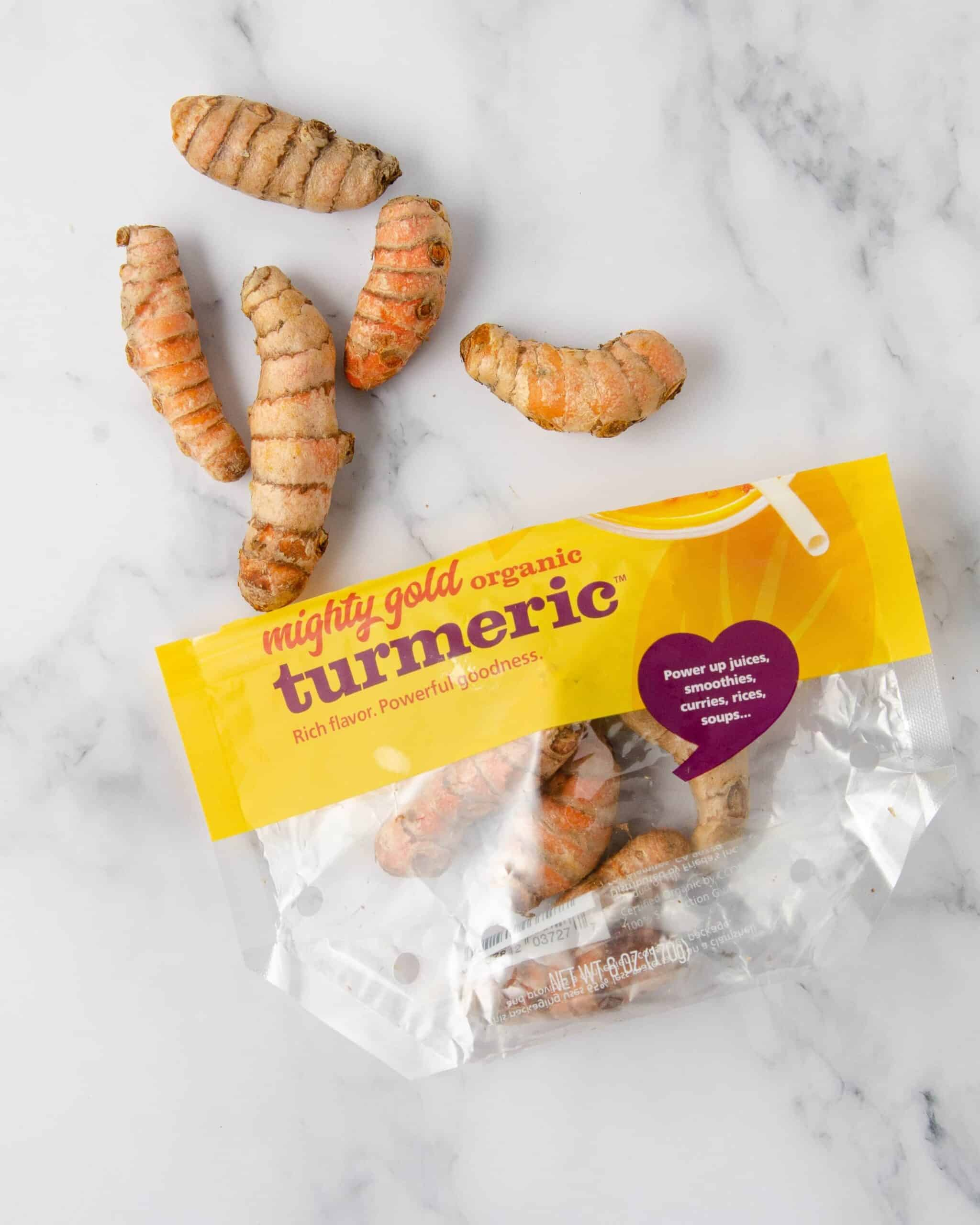 a bag of turmeric root on a marble countertop