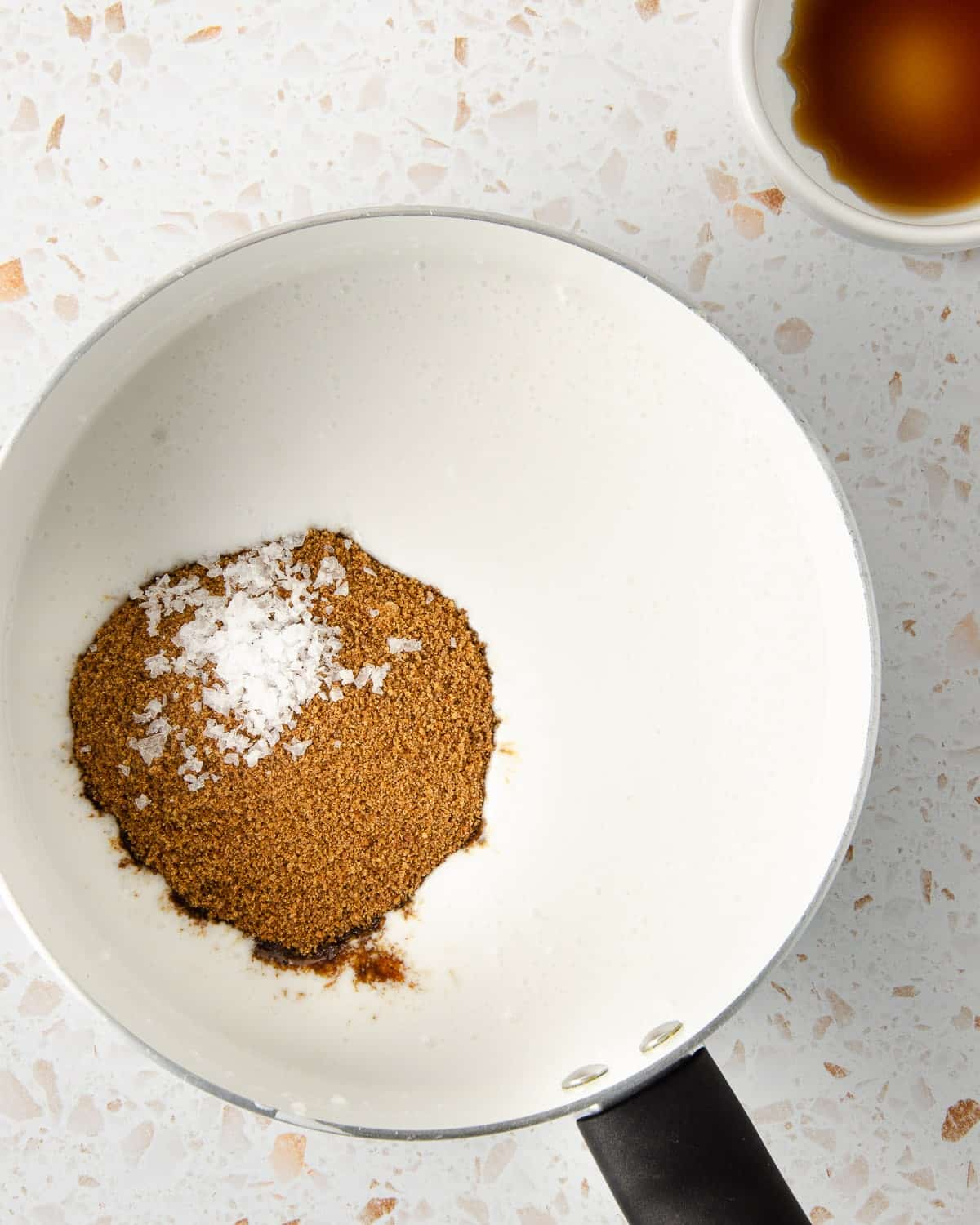 coconut cream in a small pot with coconut sugar and sea salt tossed into it.