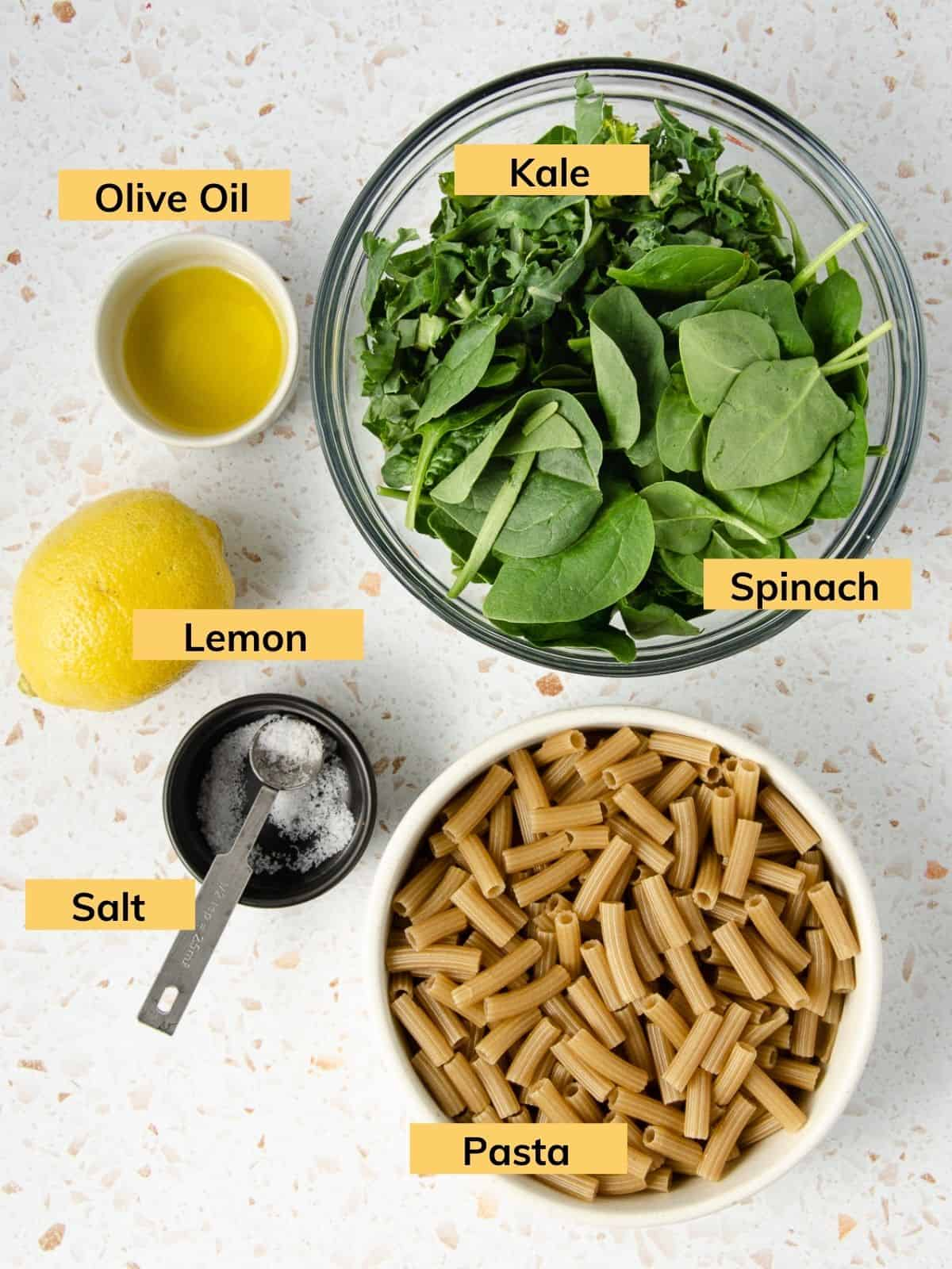 Ingredients for a green pasta sauce in bowls.