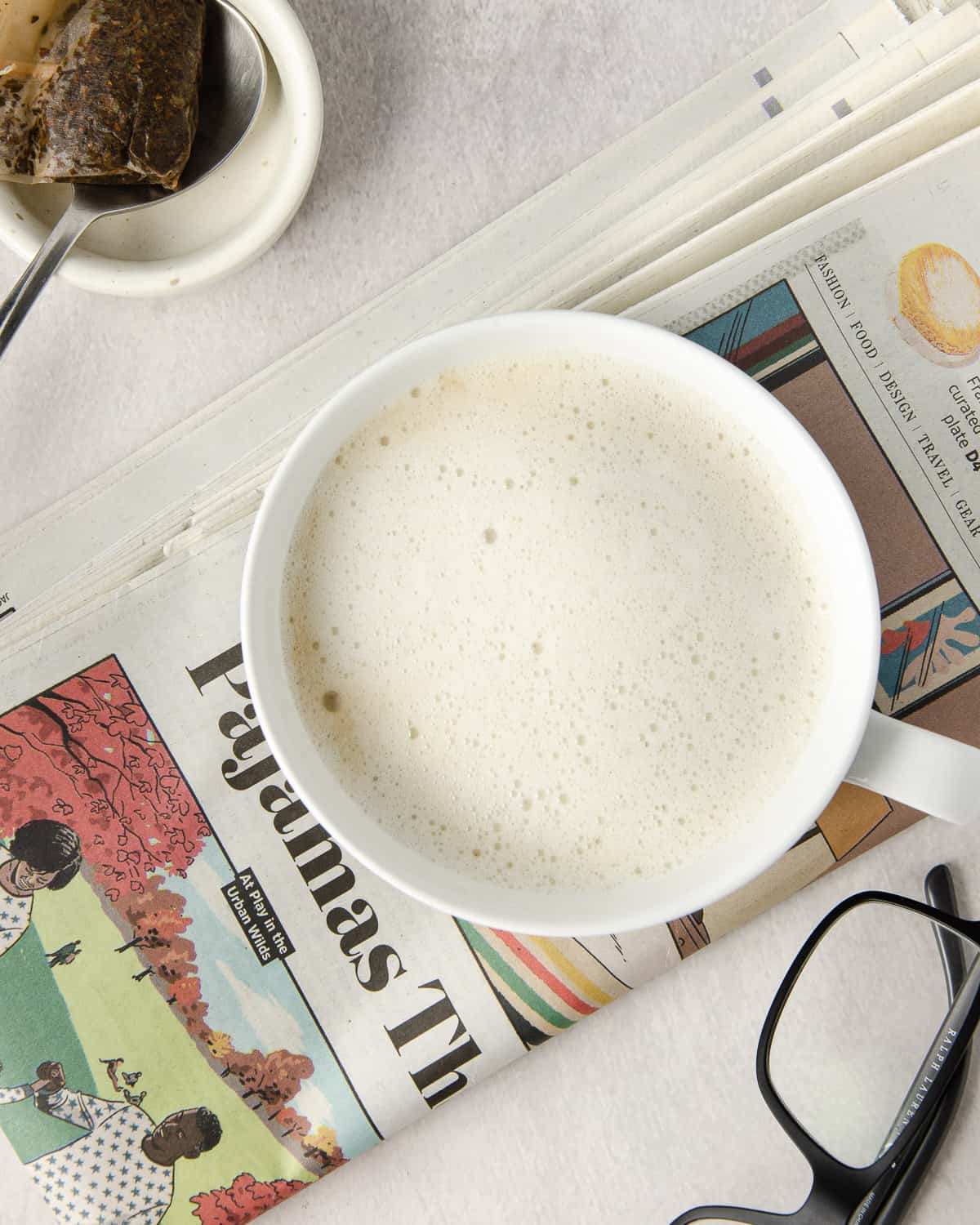 Overhead view of a london fog tea latte on top of a newspaper.