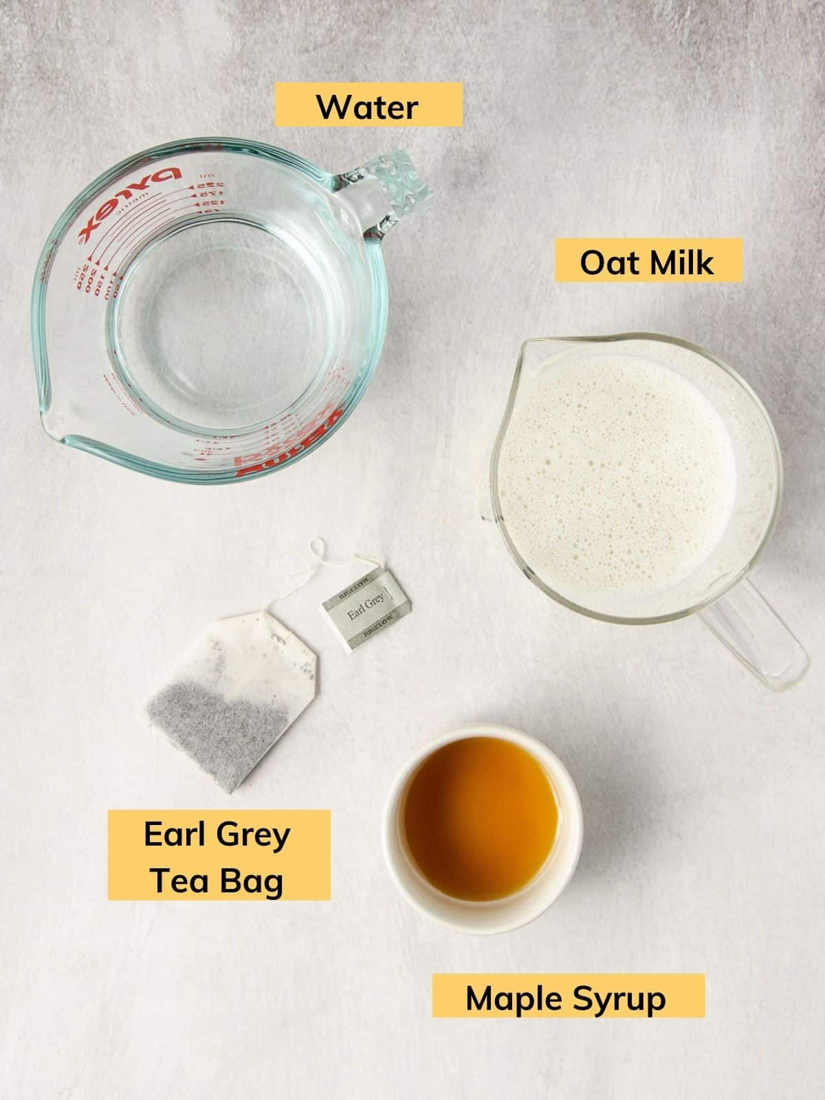 The ingredients for a london tea fog latte all in little containers.