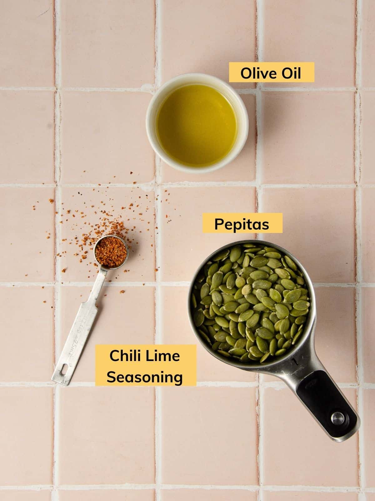 Ingredients for roasting pepitas: pepitas, chili lime seasoning and olive oil