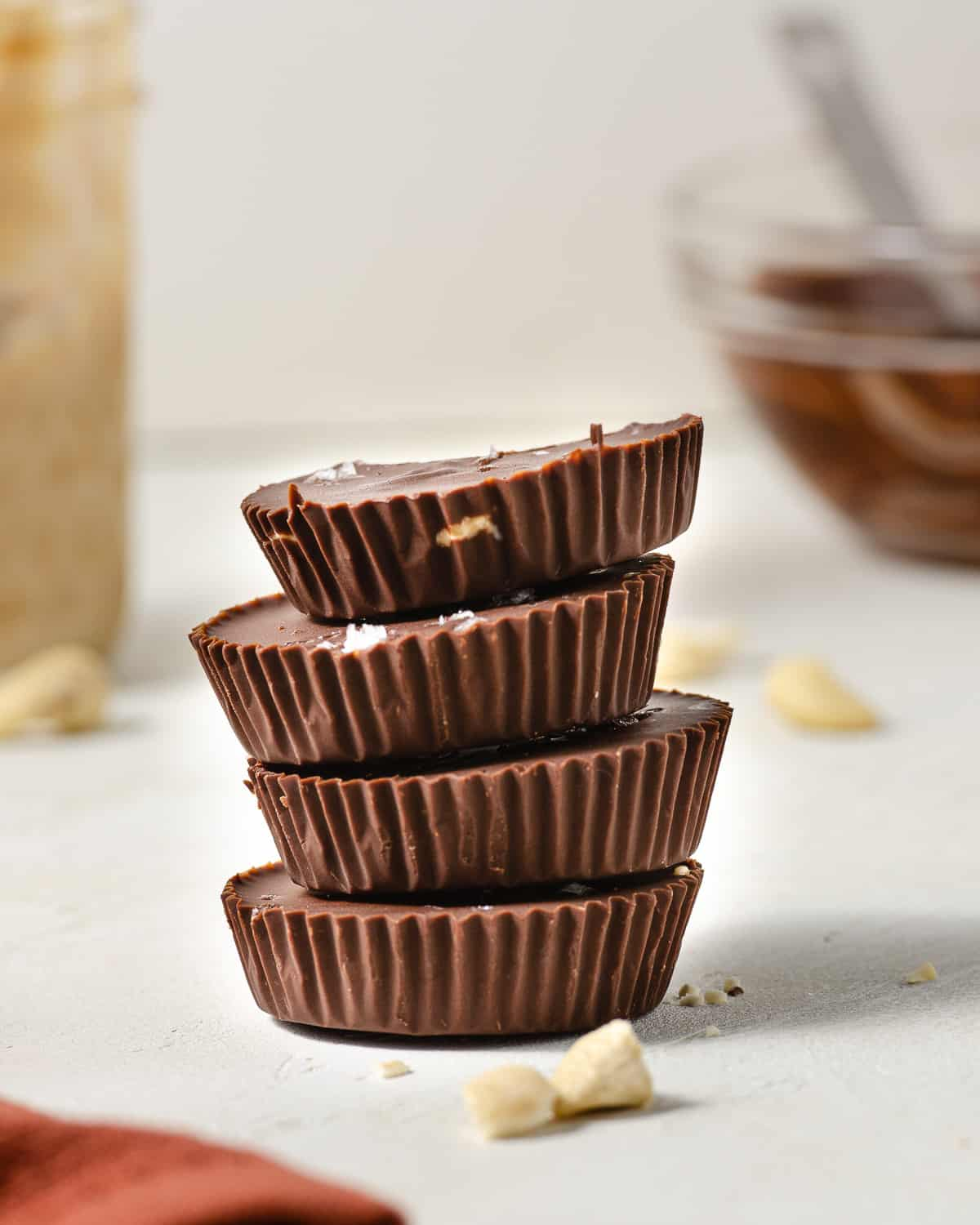 Four cashew butter cups stacked vertically.