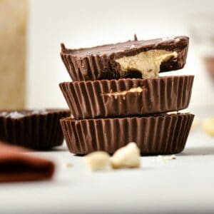 A featured image of a close up of three cashew butter cups stacked vertically.