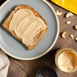Featured image of cashew butter on a toasted slice of bread.