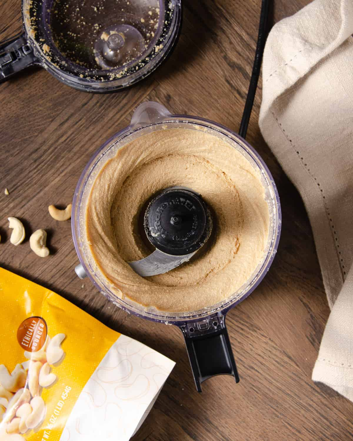 Cashews in the food processor after 5 minutes.