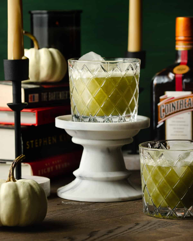One green juice margarita on a pedestal.
