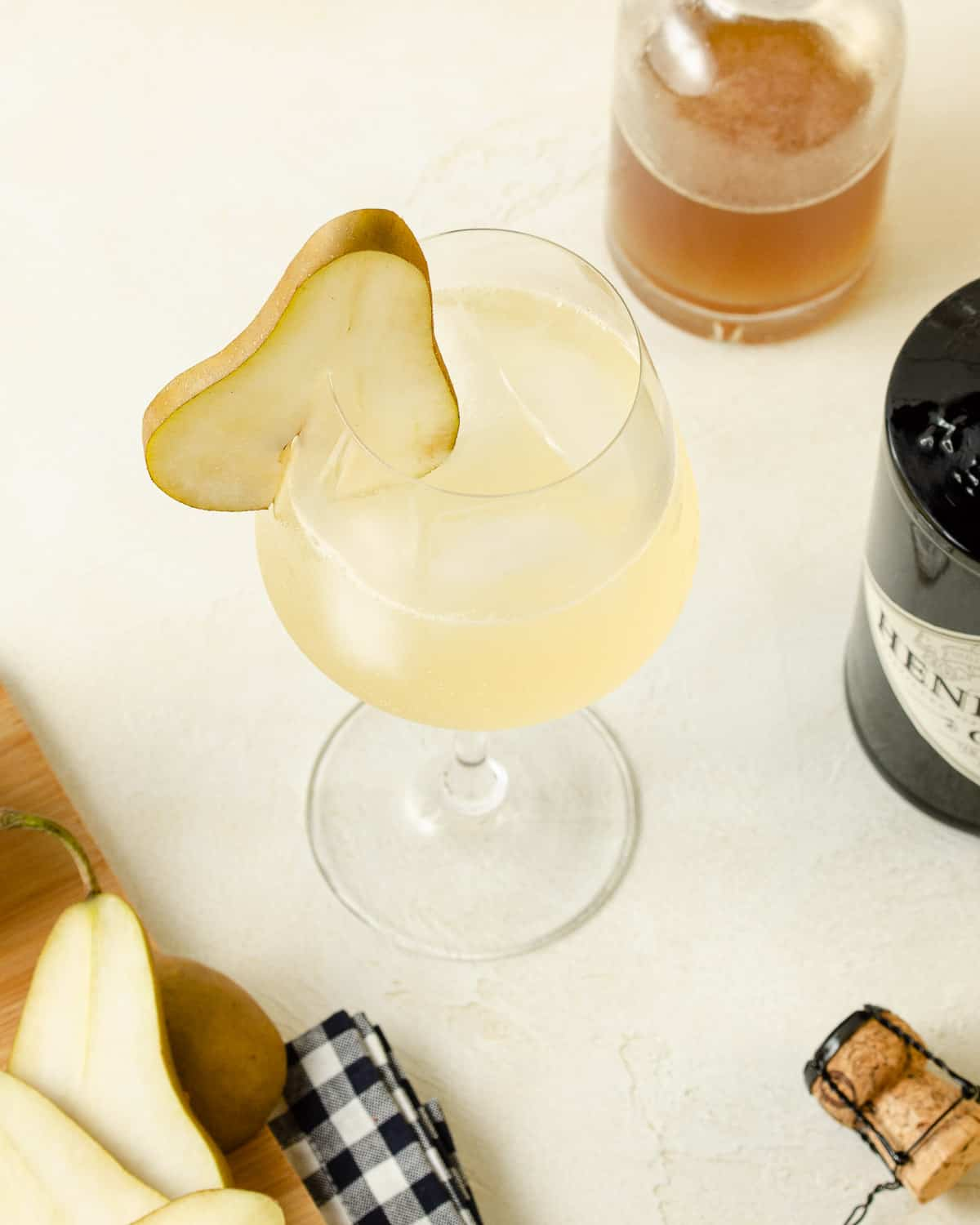 Overhead view of a honey ginger gin prosecco cocktail.