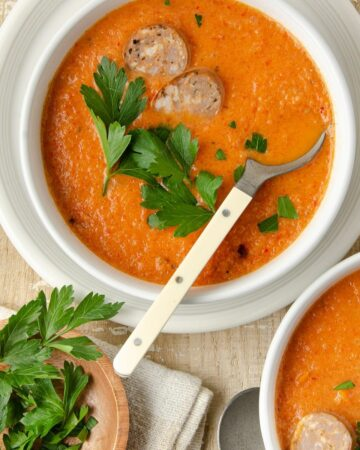 Featured square image of roasted red pepper soup.