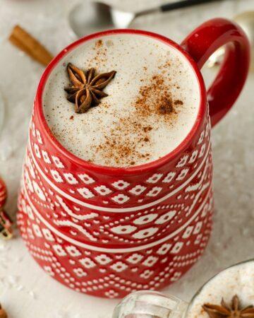 A close up of vegan eggnog in a Christmas mug.