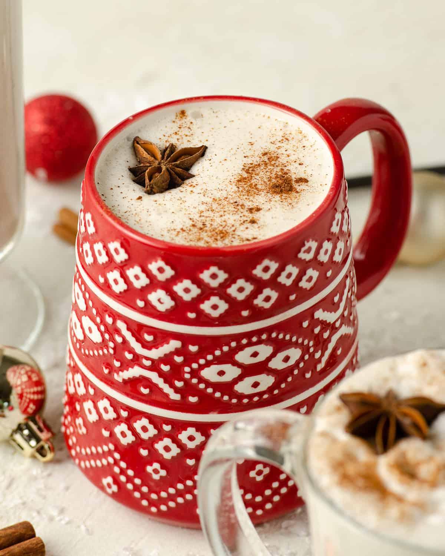 A Christmas mug filled with vegan eggnog.