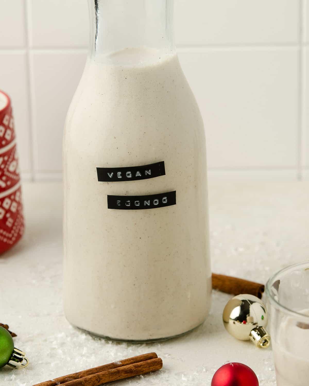 A jar of vegan eggnog on the table.